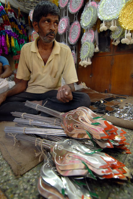A man selling weapons that the Goddess carries.