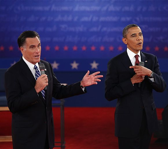 Republican presidential candidate Mitt Romney and US President Barack Obama talk over each other as they answer questions