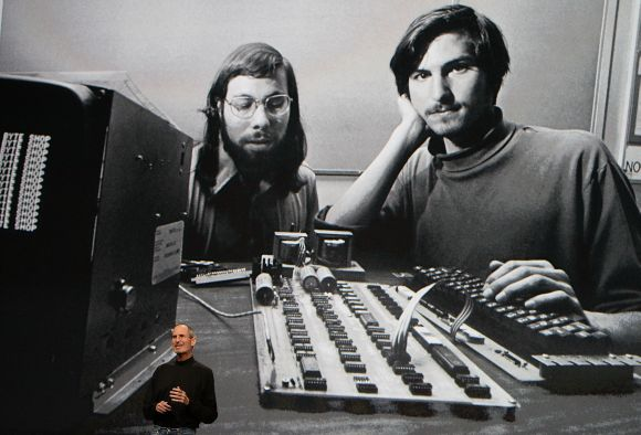Steve Jobs, right, at an Apple event at the Yerba Buena Center for the Arts in San Francisco