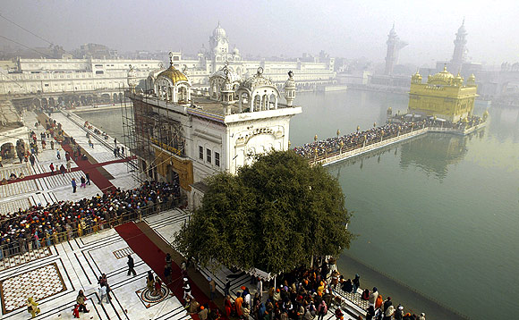 Devotees throng the fog-covered Golden Temple in Amritsar.
