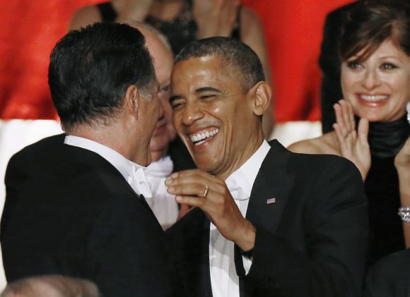 U.S. President Obama and Mitt Romney meet on stage at the 67th Annual Alfred E Smith Memorial Foundation dinner i