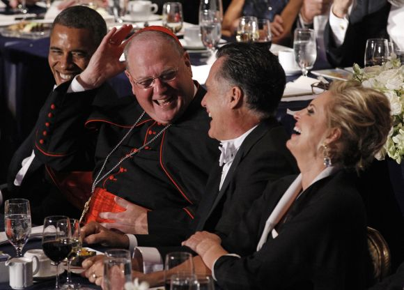 Cardinal Dolan shares a laugh with Obama, Romney and his wife Ann at the Alfred E. Smith Memorial Foundation dinner in New York