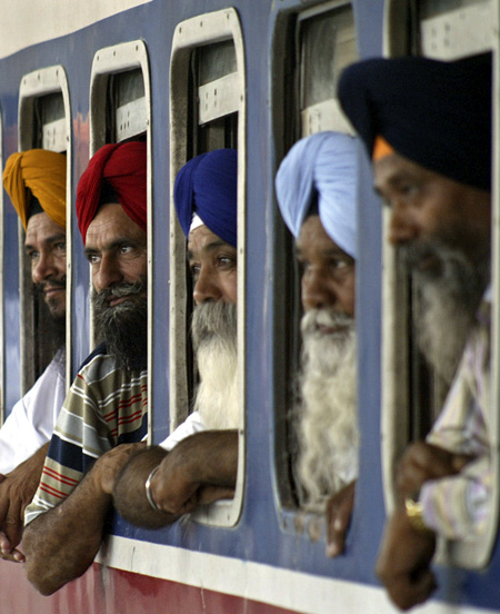 Indian Sikh pilgrims board a train to Pakistan to take part in the Martyrdom Day celebrations of Guru Arjun Dev.