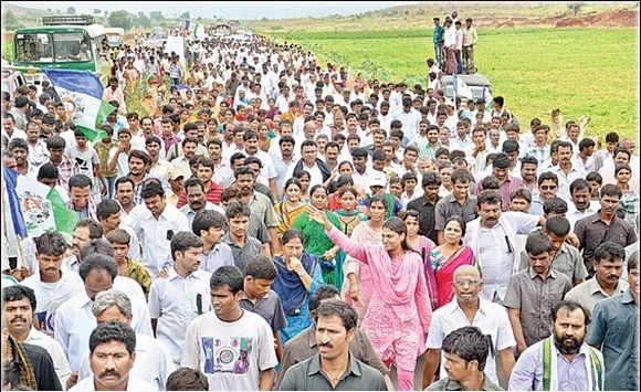 Sharmila waves to supports during her ongoing padyatra in Kadapa distict
