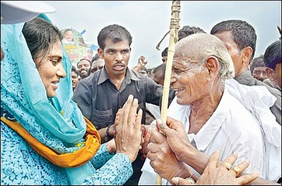 YSR Congress leader Sharmila speaks to an elderly person during her ongoing padyatra