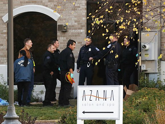 Investigators prepare to enter the Azana Salon and Spa in Brookfield, Wisconsin