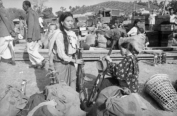 Some of the wives and families of soldiers of the Assam Rifles in Tezpur during the 1962 war with China