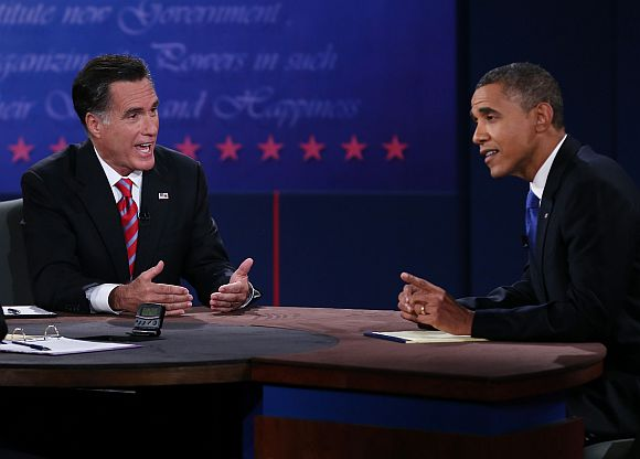 US President Barack Obama debates with Republican presidential candidate Mitt Romney as moderator Bob Schieffer listens at the Keith C and Elaine Johnson Wold Performing Arts Centre at Lynn University