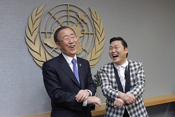 South Korean singer Psy (right) practises some 'Gangnam Style' dance steps with United Nations Secretary-General Ban Ki-moon during a photo opportunity at the UN headquarters in New York