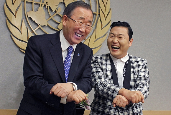 South Korean singer Psy and United Nations Secretary-General Ban Ki-moon smile after practicing some 'Gangnam Style' dance steps during a photo opportunity at the UN headquarters in New York