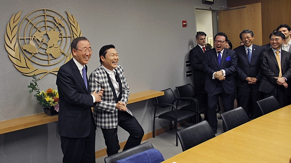 Psy practises some 'Gangnam Style' dance steps with United Nations Secretary-General Ban Ki-moon during a photo opportunity at the UN headquarters in New York