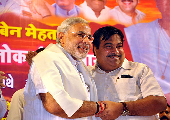 Gadkari and Gujarat Chief Minister Narendra Modi exchange a warm hug.