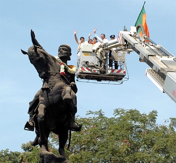 Gadkari garlands Chhatrapati Shivaji's statue.