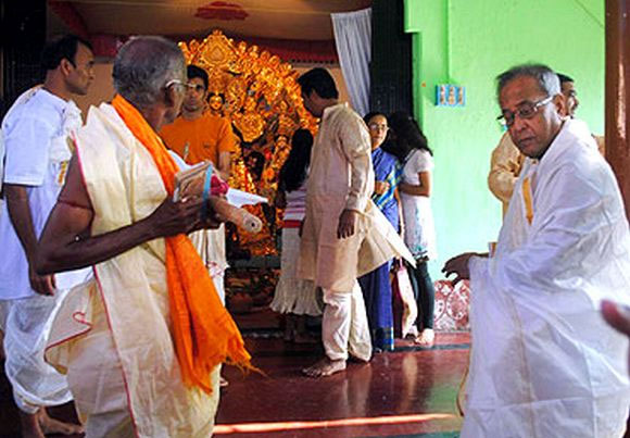 From our archives: Pranab Mukherjee with his family members during the Durga Puja celebrations at his ancestral home in this 2011 photograph.