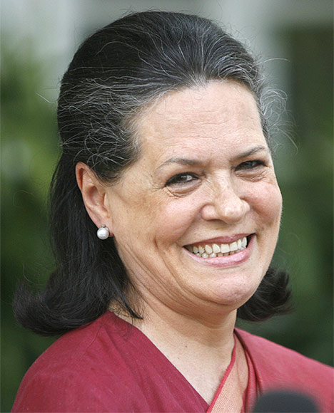 Congress Party President Sonia Gandhi beams for the cameras.