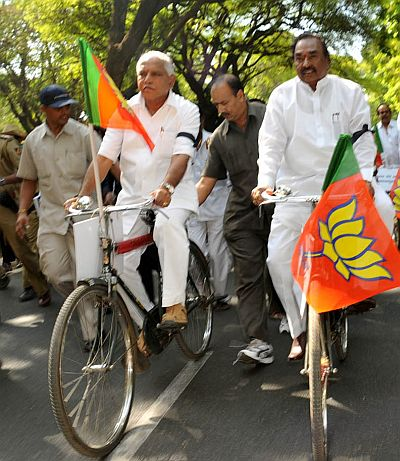 Yeddyurappa with Eshwarappa on a cycle rally