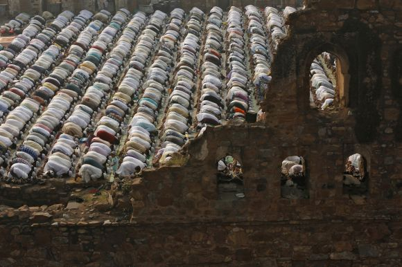 Muslims offer prayers at the ruins of the Feroz Shah Ko