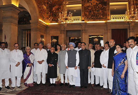 President Mukherjee, Vice President Hamid Ansari and Prime Minister Manmohan Singh with the newly inducted ministers after the swearing-in ceremony at Rashtrapati Bhavan on Sunday