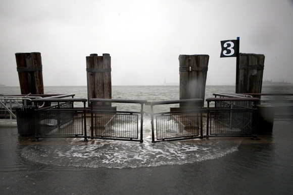 Rising waters break the banks at Battery Park as Hurricane Sandy makes its approach in New York