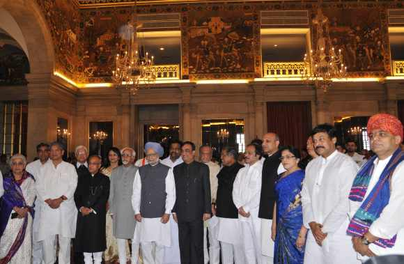 President Pranab Mukherjee, Vice President Hamid Ansari and Prime Minister Dr Manmohan Singh with the newly inducted ministers after a swearing-in ceremony at Rashtrapati Bhavan