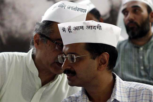 Arvind Kejriwal and fellow activist Prashant Bhushan, left, partly seen