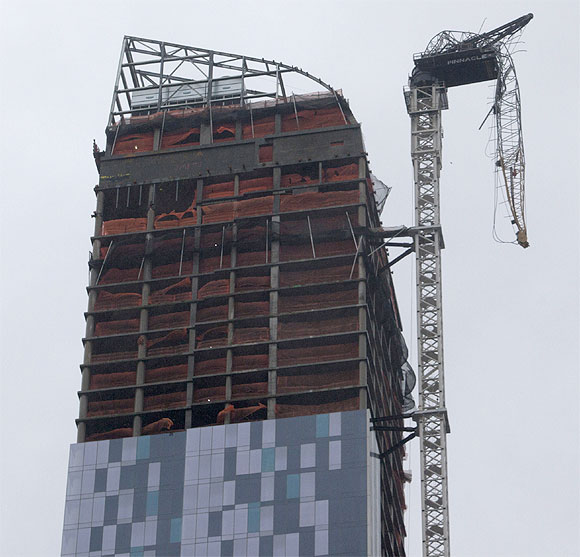Sandy batters NY: Crane dangles from high-rise, cars float!