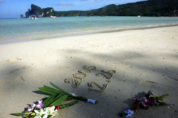 Flowers are laid on a beach during a memorial ceremony marking the one-year anniversary of the Indian Ocean tsunami