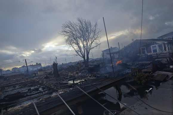 Homes devastated by fire and the effects of Hurricane Sandy are seen the Breezy Point section of the Queens borough of New York.