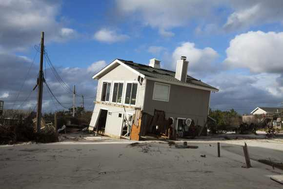 Superstorm Sandy recedes, leaves US battered