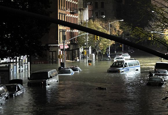 A general view of submerged cars on Ave. C and 7th st, after severe flooding caused by Hurricane Sandy in Manhattan, New York