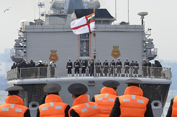Russian sailors look on as the Indian navy's INS Delhi arrives in Russia's far eastern port of Vladivostok