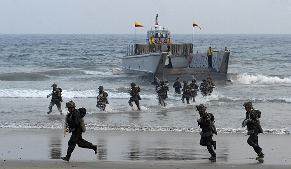 Indian Marine Commandos perform during the annual Navy Day celebrations at Ramakrishna Beach in Visakhapatnam
