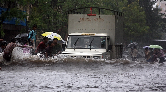 A truck wades through a water-logged street in Thane