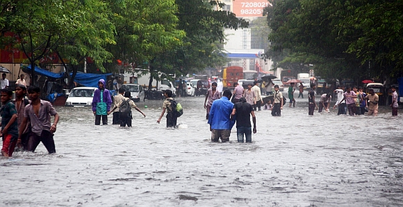 Rains hit road, rail traffic in Mumbai, Thane
