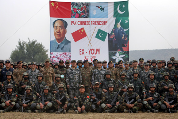 Members of the Pakistan Army and the Chinese People's Liberation Army pose for a group photo after joint military exercises