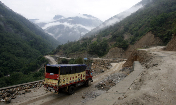 A delivery truck drives along India's Tezpur-Tawang highway which runs to the Chinese border in Arunachal Pradesh