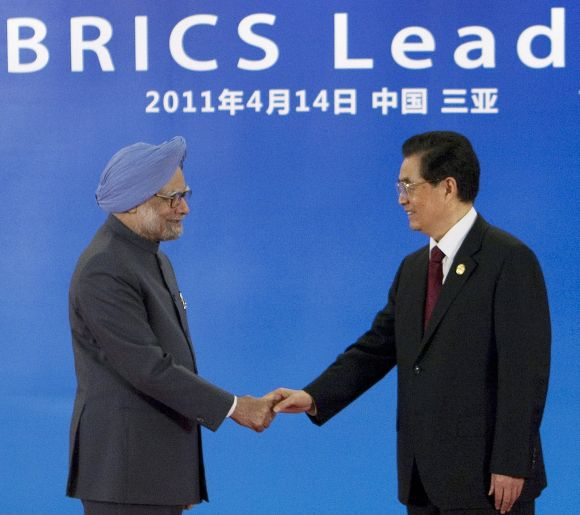 Dr Singh is greeted by China's President Hu Jintao during the 2011 BRICS Leaders Meeting in Sanya