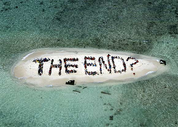 Hundreds of Belizians and international supporters gather on an island to form a message on the Barrier Reef off the coast of Belize City