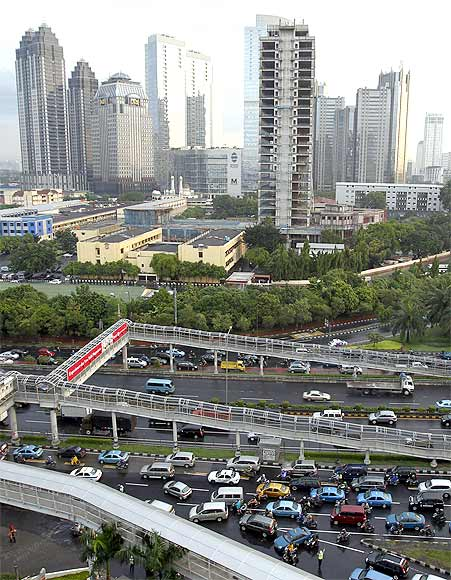 Traffic moves slowly along the heavily congested main roads of Indonesia's capital Jakarta