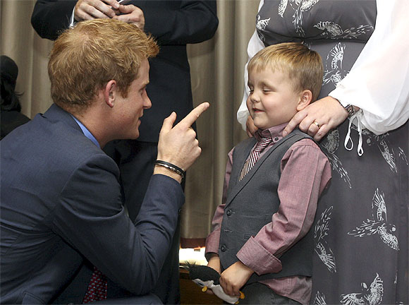 Prince Harry talks to Alex Logan