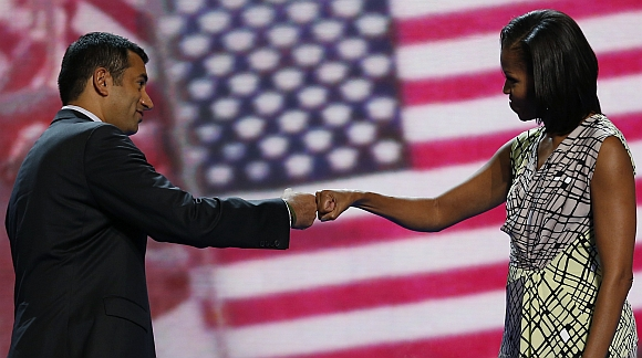 US first lady Michelle Obama 'fist-bumps' actor and Obama administration official Kal Penn, the associate director of the White House Office of Public Engagement, as she tours the stage a day before her speech to the Democratic National Convention in Charlotte, North Carolina