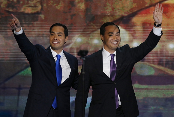 Julian Castro (left), Mayor of San Antonio, Texas, waves with his brother, US Congressional candidate Joaquin Castro, after Joaquin introduced his brother to deliver the keynote address during the first day of the Democratic National Convention in Charlotte, North Carolina