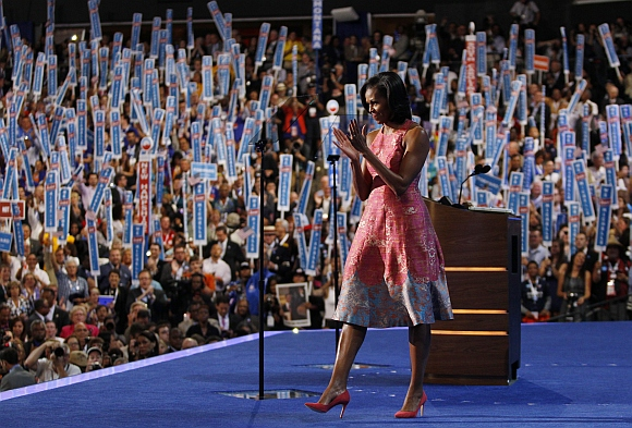 US first lady Michelle Obama applauds after concluding her address to delegates during the first session of the Democratic National Convention in Charlotte, North Carolina
