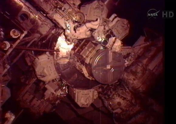 NASA Flight Engineer Sunita Williams (L) and Japan Aerospace Exploration Agency Flight Engineer Akihiko Hoshide take part in a spacewalk outside the International Space Station on August 30