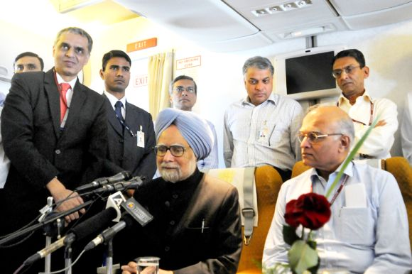 The prime minister briefs the media on board his aircraft while returning from the NAM Summit in Tehran on August 31.