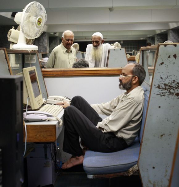 A man works on his computer in Karachi