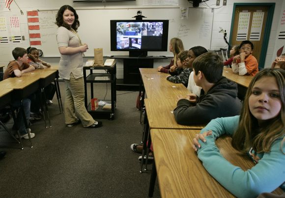 Students answer questions via Internet at a school in Winnipeg, Canada.