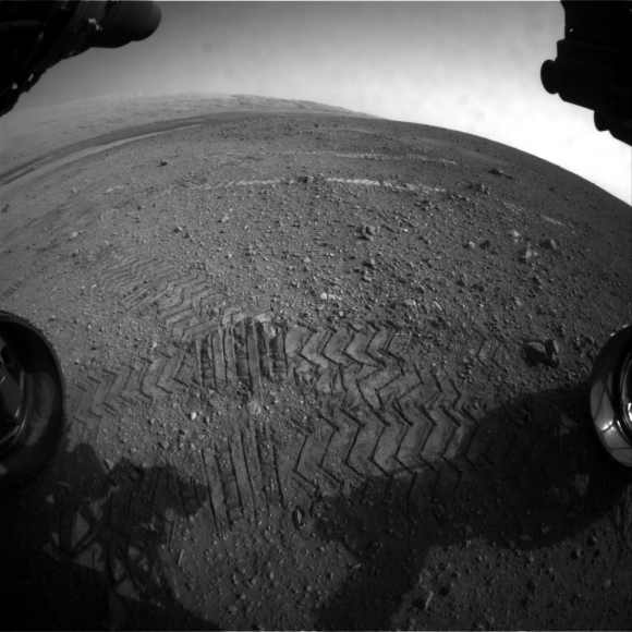 This image taken by a front Hazard-Avoidance camera on NASA's Curiosity shows track marks from the rover's drives