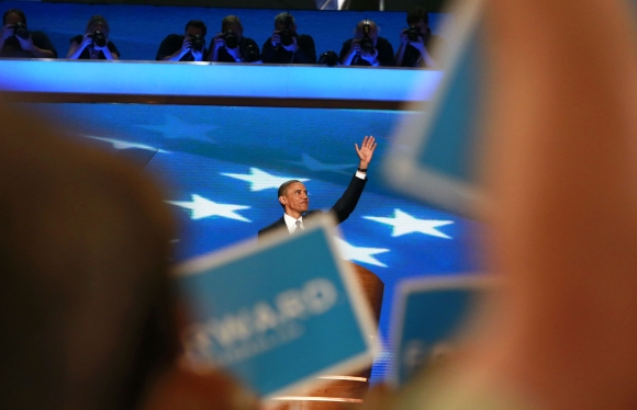 Delegates wave signs and cheer as US President Barack Obama accepts the 2012 Democratic presidential nomination