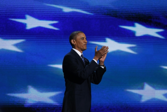 US President Barack Obama arrives on stage to address the final session of the Democratic National Convention
